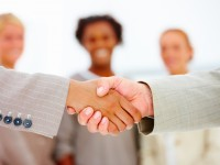 bigstockphoto_Business_People_Shaking_Hands__4035635