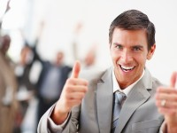bigstockphoto_Delighted_Business_Man_With_Hi_4925448